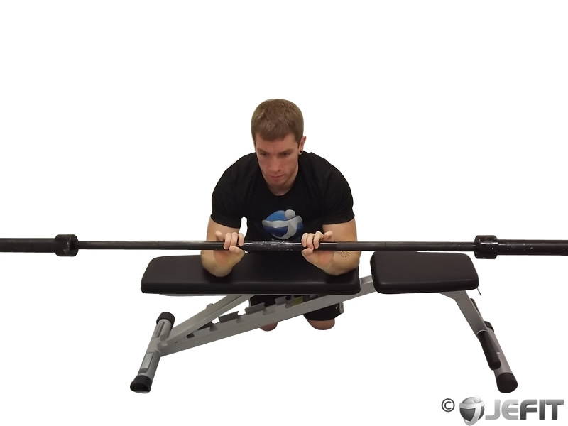 Palms Down Barbell Wrist Curl Over A Bench